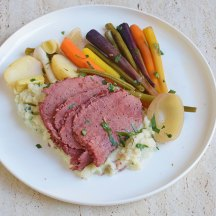 Corned beef with spring vegies and cauliflower mash