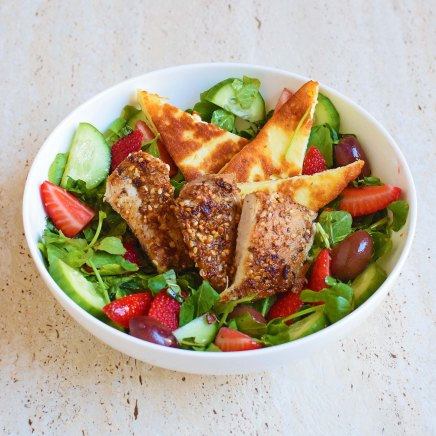 Za'atar chicken with strawberry, haloumi and olive salad