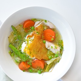 Pretty Spring Pot Au Feu from Simplicious, topped with a poached egg and crispy Chicken Crackle skin