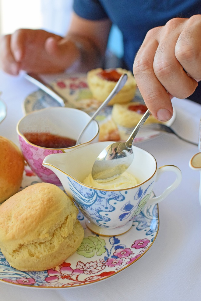 MAN HANDS - on scones with jam and cream